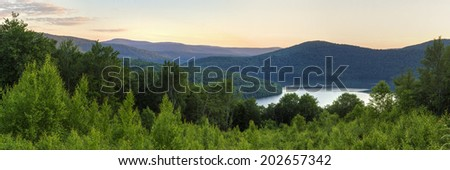 Panoramic view of the Pepacton Reservoir and Catskills Mountains at sunset from the Shaverton Trail overlook  in Andes, New York - stock photo