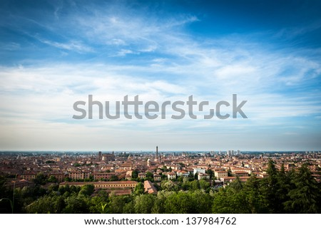 Panoramic view of the roofs of Bologna with blue sky. - stock photo