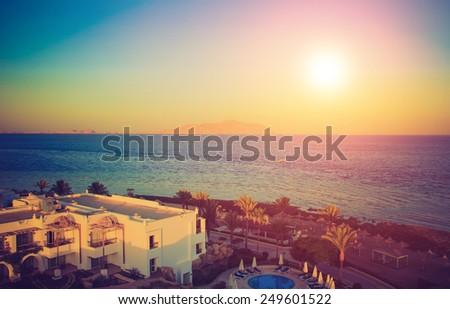Panoramic view of the sea and promenade at sunset. Filtered image:cross processed lomo effect.   - stock photo