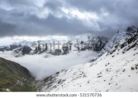 panoramic view of the snow-capped mountains of the Stelvio Pass (Italy)