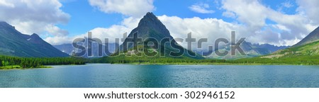 panoramic view of the swiftcurrent lake in Glacier National Park in summer