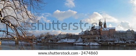Panoramic view of the Swiss city of Basel during the winter months. - stock photo