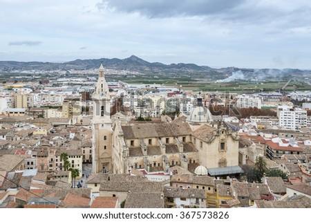 Panoramic view of the Xativa city and the Collegiate Basilica of Santa Maria of Xativa. Valencia, Spain. - stock photo