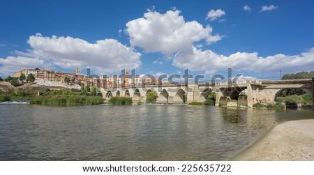 Panoramic view of Tordesillas with Duero River, beach and bridge - stock photo