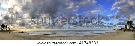 Panoramic view of tropical cuban beach at sunset with dramatic clouds - stock photo