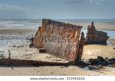 Panoramic View of Vilanculos Beach in Mozambique during low tide. One can see the various dhows resting in the sand. - stock photo