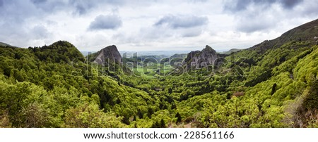 Panoramic view of volcanic landscape at the Auvergne region, France - stock photo