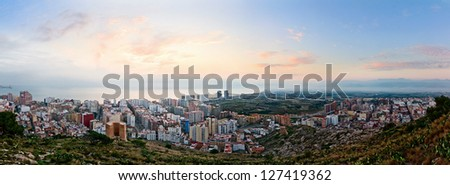 Panoramic view on a small spanish city Cullera (Valencia, Spain) at sunrise - stock photo