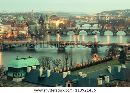 Panoramic view on Charles bridge and evening Prague.  Beautiful famous place in Bohemia - stock photo