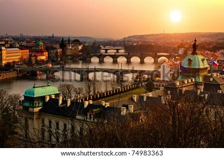 Panoramic view on Charles bridge and sunset Prague lights. Bohemia, Czech Republic - stock photo