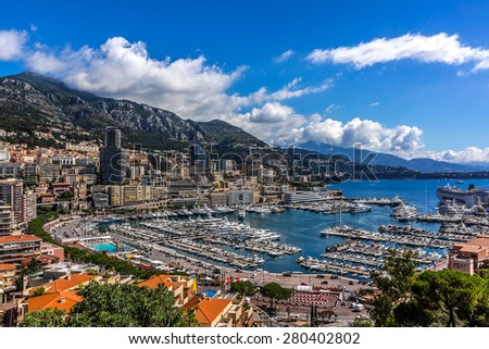 Panoramic view on excellent residential buildings and marina in Monte Carlo, Monaco. Principality of Monaco is a sovereign city state, located on the French Riviera in Western Europe. - stock photo