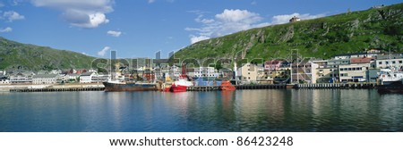 Panoramic view on harbour of the small town of Kirkenes is known as the capital of the Barents Region and the gateway to the East - stock photo