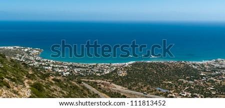 Panoramic view on Malia town and Agia Pelagia coastline. Crete. Greece - stock photo
