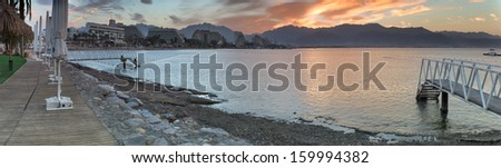 Panoramic view on the Aqaba gulf from the central beach of Eilat, Israel - stock photo