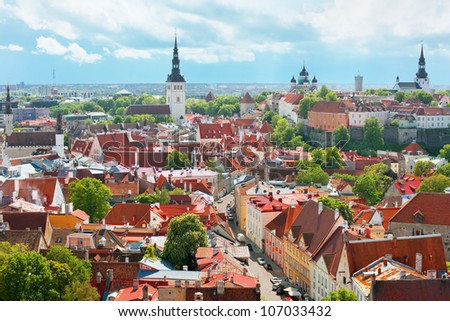Panoramic view on the Old City of Tallinn under the cloud sky; - stock photo