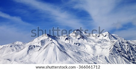 Panoramic view on winter snowy mountains in windy day. Caucasus Mountains, Georgia, region Gudauri. - stock photo