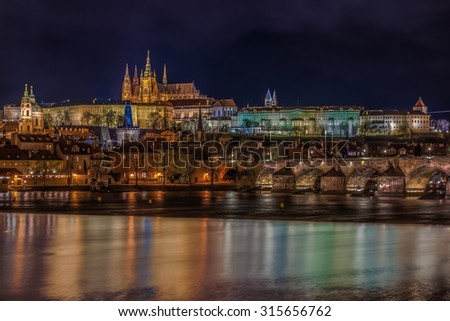 Panoramic view onto Prague Castle - Saint Vitus's cathedral and Charles Bridge in Prague, Old Town at night