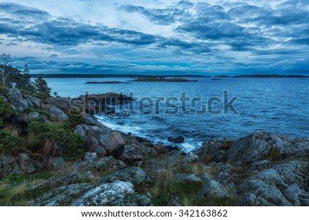 Panoramic view over archipelago landscape in dusk - stock photo
