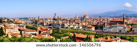 Panoramic view over Florence, Italy with Duomo and Palazzo Vecchio - stock photo