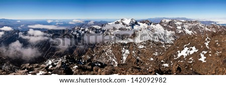Panoramic view over Moroccan High Atlas mountains with snow covered peaks - stock photo