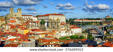 Panoramic view over the old town of Porto, Portugal, with the cathedral, Dom Luis I Bridge, Serra do Pilar monastery and port wine cellars - stock photo