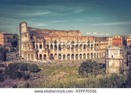 Panoramic view the Coliseum in Rome, Italy. The Colosseum is the main tourist attractions of Rome. It was built in the 1st century.  - stock photo