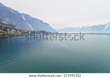 Panoramic View to Montreux and Lake Geneva in winter. Montreux is a city in the canton of Vaud in Switzerland. It is located on Lake Geneva at the foot of the Alps.