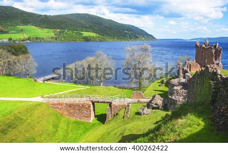 Panoramic view to Ruins of Urquhart Castle in Loch Ness in Scotland. Loch Ness is a city in the Highlands in Scotland in the United Kingdom. - stock photo