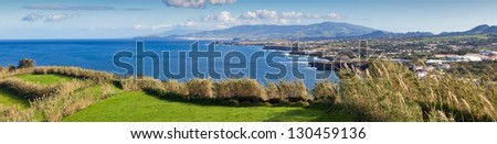 Panoramic view to the green field, town and mountains at the Atlantic ocean coast, San Miguel, Azores, Portugal - stock photo