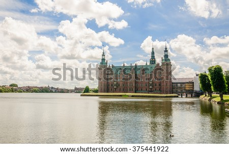 Panoramic view to the lake around Frederiksborg Slot, Hillerod, near Copenhagen, Denmark - stock photo