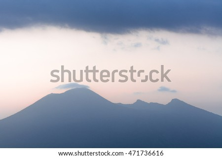 Panoramic view with mount Vesuvius. Mount Vesuvius silhouette and with foggy sky, Italy.