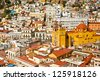 Panoramic vista of colorful buildings in downtown Guanajuato Mexico - stock