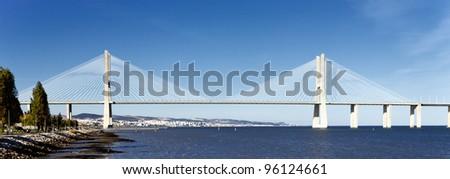 panoramic viw of Vasco da Gama bridge in Lisbon, Portugal - stock photo