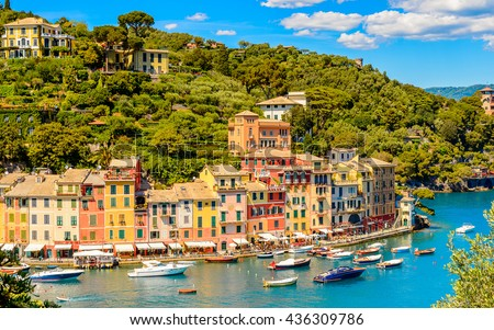 Panoramiv view of Portofino, is an Italian fishing village, Genoa province, Italy. A vacation resort with a picturesque harbour and with celebrity and artistic visitors.