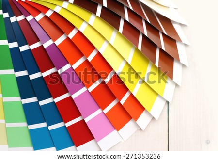 Pantone color palette on white wooden background, close up - stock photo