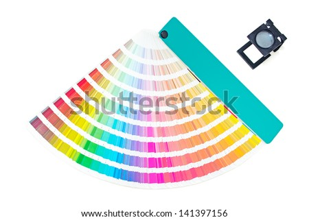 Pantone pallete with magnifying glass - stock photo
