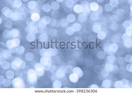pantone serenity color bokeh circular from the christmas background