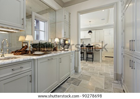 Pantry in luxury home with view into kitchen - stock photo