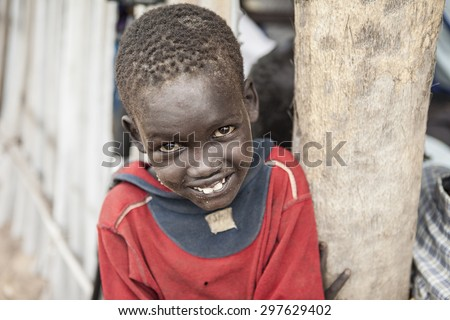 PANWEL, SOUTH SUDAN-NOVEMBER 2, 2013: Portrait of young boy of the Dinka tribe in a village in South Sudan - stock photo