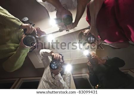 Paparazzi Photographers Shooting a Murder Victim - stock photo