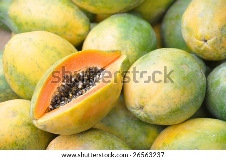 Papaya fruit cut and whole. - stock photo