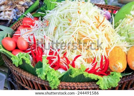 papaya or green papaya salad, chopped papaya to make papaya salad, papaya fibers were chopped to prepare a salad - stock photo