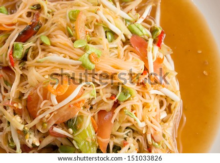 Papaya salad on  white dish