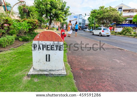 PAPEETE, FRENCH POLYNESIA - JULY 27, 2016 :  A  Zero Kilometer stone on the road in the town of Papeete early in the morning in Tahiti  Papeete, French Polynesia on July 27, 2016