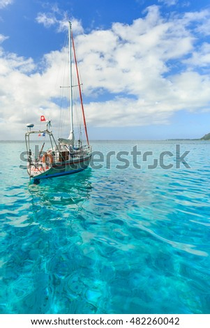 PAPEETE, FRENCH POLYNESIA - SEPTEMBER 12, 2016 : The Beautiful sea and sailing boats in Moorae Island at Tahiti PAPEETE, FRENCH POLYNESIA on September 12, 2016
