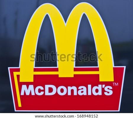 PAPENBURG, GERMANY - DEC 14: McDonald's logo  on December 14, 2013 in Papenburg, Germany. McDonald's Corporation is the world's largest chain of hamburger fast food restaurants.  - stock photo