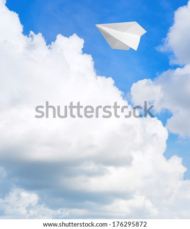 Paper airplane flying in the sky - stock photo