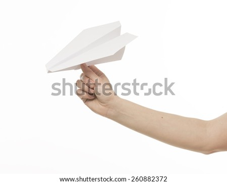 paper airplane in a female hand, isolated on white - stock photo