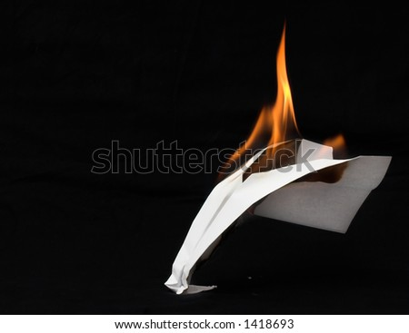 Paper airplane in flames