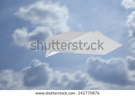 Paper Airplane in swallow shape on blue skies with motion blur